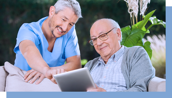 Elderly man looking over assessment results with son on tablet, saving time and money