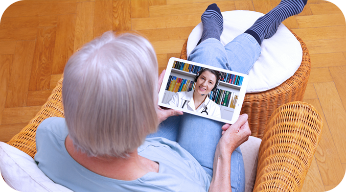 Top view of elderly lady in a video call with doctor to discuss condition and prevent unnecessary hospital readmission saving travel time and costs