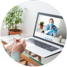 Virtual meeting with doctor on laptop to discuss prescription medication