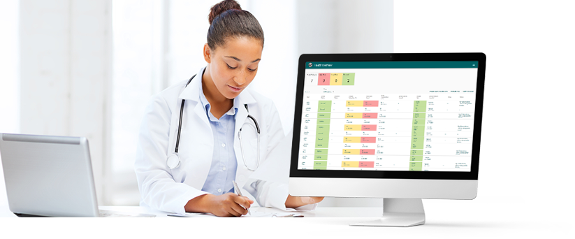 Doctor looking at aTouchAway dashboards to review patient information at a glance