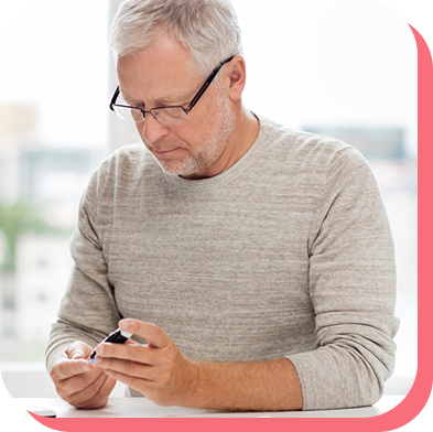 Man testing his glucose levels to input into aTouchAway for care advice, such as reducing insulin levels