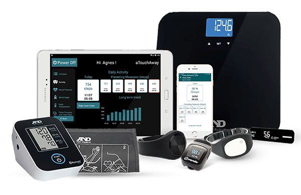 Group of health monitoring devices, like a digital scale, watches, blood pressure machine and a tablet and smartphone with the aTouchAway application opened