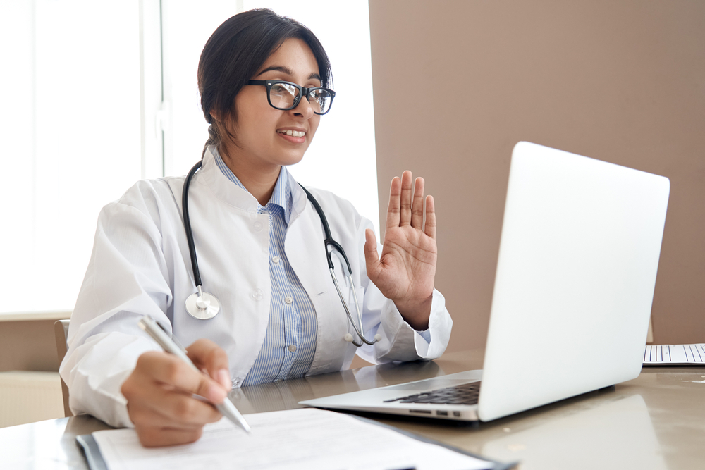 Female doctor virtually consulting patient