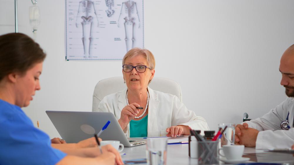 Female doctor leading team meeting