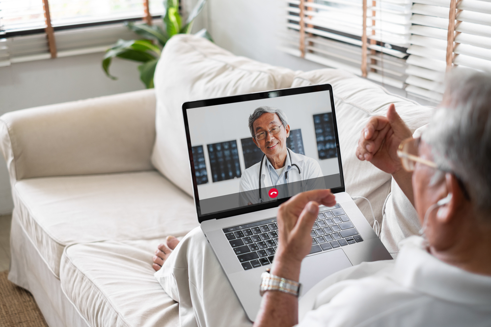Male patient speaking to doctor on video call