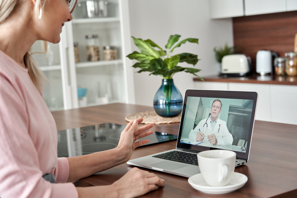 Doctor consulting woman virtually