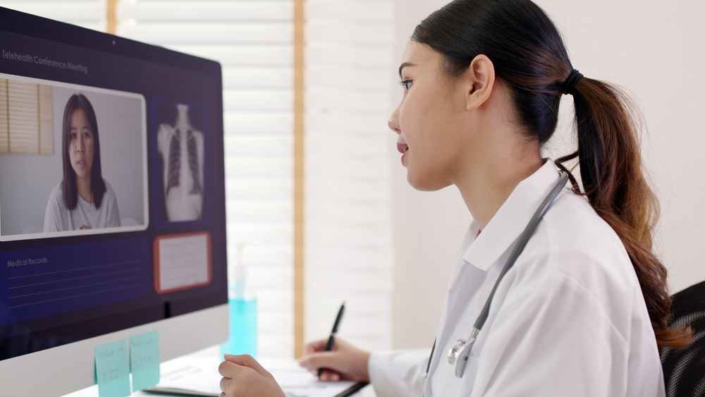 Female doctor virtually consulting COPD patient